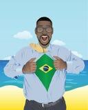 商人显露巴西旗子的开头衬衣 库存照片
