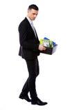 商人有个人财产的举行箱子 免版税库存照片