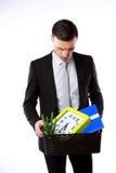 商人有个人财产的举行箱子 免版税库存图片