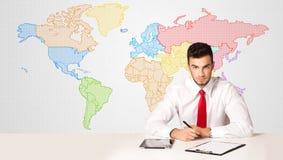 商人有五颜六色的世界地图背景 图库摄影