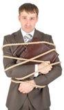 年轻商人栓与绳索 免版税图库摄影