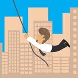 商人横跨大厦、风险和兴奋的一条绳索 库存例证