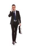 商人电话联系的走 免版税库存图片
