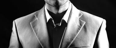 商人画象,低调在黑背景,黑白照片 库存照片