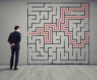 商人画迷宫的解答 解决问题的概念 库存图片