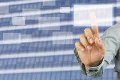 商人的手指向空的长方形光源在sk的 图库摄影