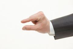 商人的手显示小型 图库摄影