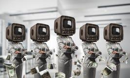 商人的电视瘾 免版税图库摄影