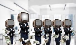 商人的电视瘾 免版税库存照片