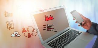 商人的综合图象使用膝上型计算机和手机的 免版税库存图片
