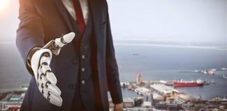 商人的综合图象用接近为握手3d的机器人手 免版税图库摄影