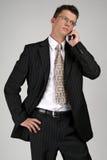 商人移动电话联系 免版税库存图片