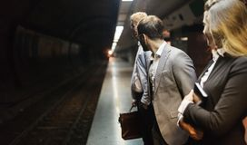商人等待的地铁 免版税库存图片