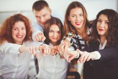 商人编组队点手指在您,在办公室 企业例证JPG人向量 图库摄影