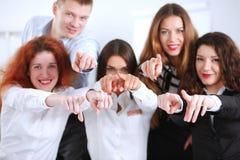 商人编组队点手指在您,在办公室 企业例证JPG人向量 免版税库存图片