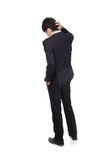 年轻商人背面图被迷惑 免版税图库摄影
