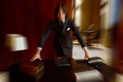 商人被弄脏的五颜六色的背景豪华内部的 库存图片