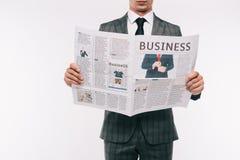商人读书商业报纸的播种的图象 库存照片