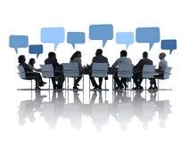商人谈论在会议 库存图片