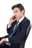 年轻商人谈话在电话。 免版税库存照片