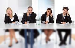 商人谈话在电话在会议上 免版税库存照片