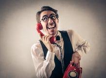 商人谈话在电话 库存照片