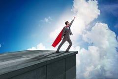 商人超级英雄成功在事业梯子概念 库存图片
