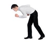 商人蹲下步行 免版税图库摄影