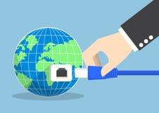 商人连接的插座到世界里 免版税库存照片
