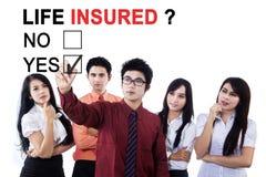 商人满意的生活被保险人 免版税库存图片