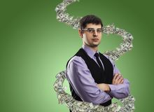 商人画象与金钱漩涡的 免版税图库摄影