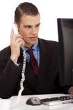 商人profesional坐的年轻人 库存图片