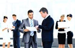 商务伙伴谈论的图象 免版税库存图片