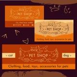 商标、象征商店猫的和狗 动画片 库存照片
