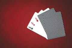 啤牌的卡片在红色背景,3种类 免版税图库摄影