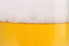 啤酒和泡沫特写镜头。 免版税图库摄影