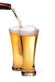 啤酒杯倾吐 免版税库存图片