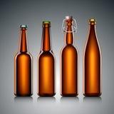 啤酒瓶没有标签的结算集 免版税库存照片