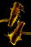 啤酒瓶飞溅 库存图片