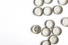 啤酒盖帽在白色背景的 免版税库存照片