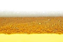 啤酒,泡沫,在白色背景隔绝的泡影 免版税库存照片