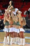 啦啦队员举行在他们的伙伴顶部 免版税库存照片