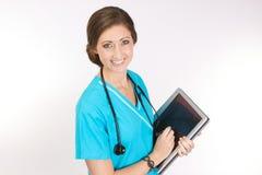 喂护士个人计算机片剂技术 图库摄影