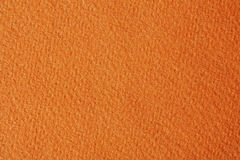 喂从橙色纸的res纹理 库存照片
