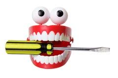 喋喋不休有螺丝刀的牙玩具 免版税库存图片