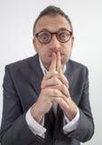 喘气哑的经理他的公司沈默或禁忌的面颊 库存照片