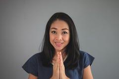 喜悦的亚裔妇女 免版税库存照片