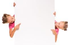 喜爱是两次曝光变了得极度兴奋她一个假装s显示姐妹姐妹孪生 免版税库存照片