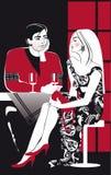 喝在咖啡馆的年轻夫妇藤 免版税图库摄影