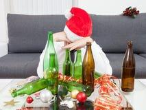 喝太多在圣诞节时间 库存照片